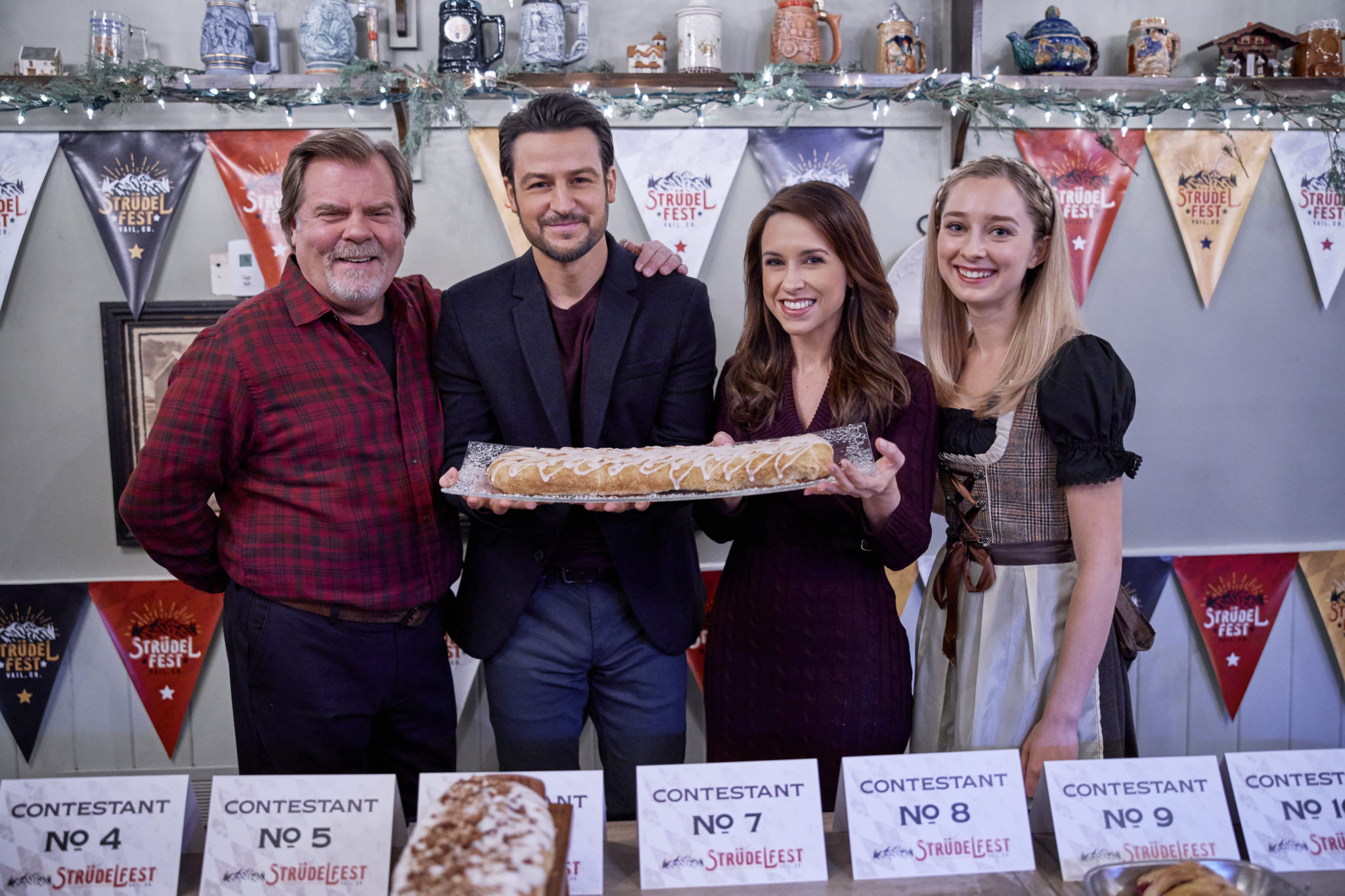 When professional event planner Chelsea Whitmore inherits a chalet in Vail, she quits her job and moves to the picturesque mountain resort to write the next chapter in her life, which just might include an unlikely romance with handsome local Owen Becker. Photo: Greg Lawson, Tyler Hynes, Lacey Chabert, Sage Kitchen Credit: ©2019 Crown Media United States LLC/Photographer:David Brown