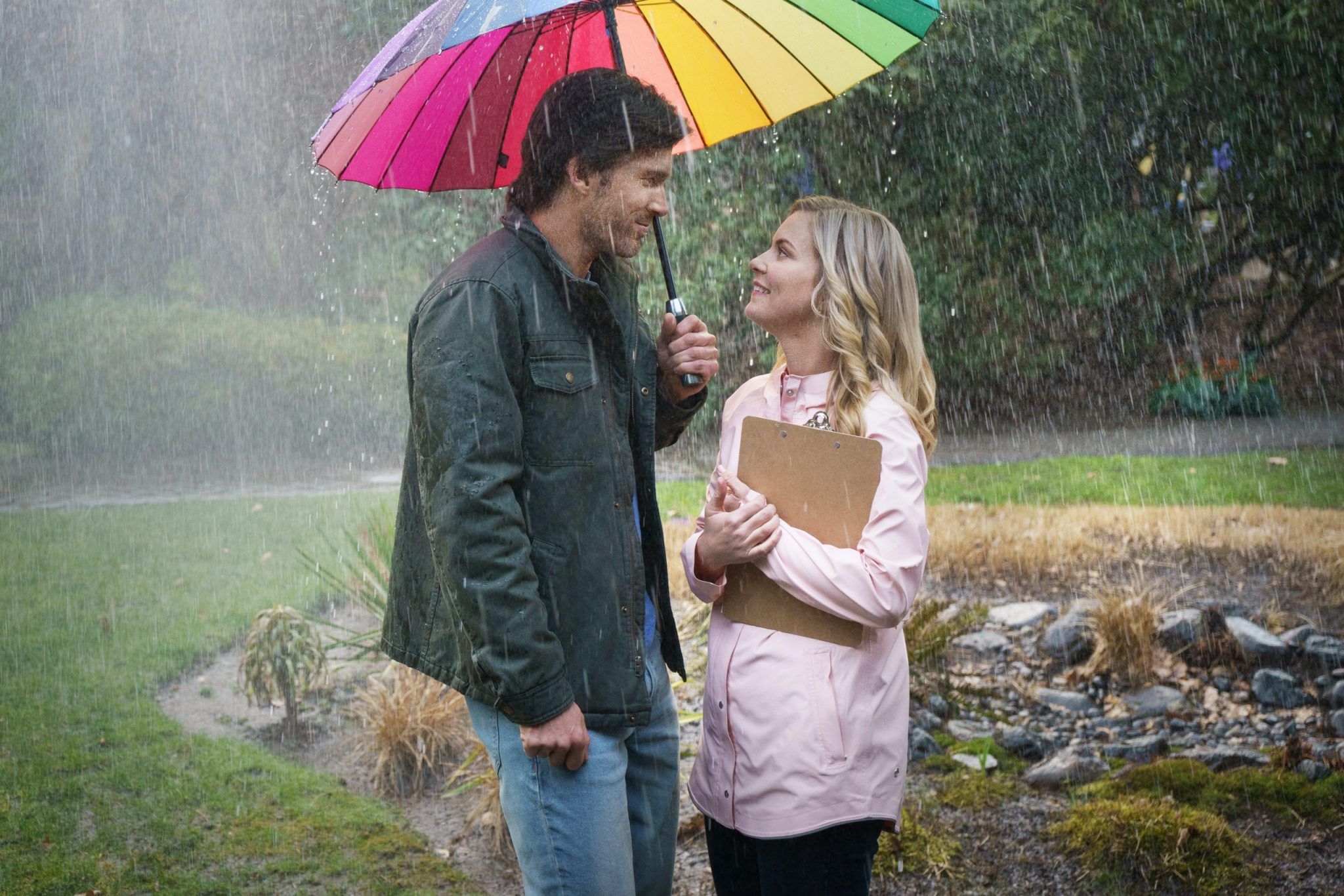 Hallmark, A Little Romance, On-air weather reporter Leah Waddell is getting weary of her bleak dating life and inability to be taken seriously as a budding meteorologist. At her wits end, she makes the decision to stay single and focus on her career for a full year. As soon as she makes this commitment, it literally starts pouring rain and men. As Leah deflects multiple romantic offers, she befriends her new neighbor Mark, a handsome dairy farmer who teaches her methods to predict the weather by observing signs in nature. Photo: Christopher Russell, Cindy Busby Credit: ©2020 Crown Media United States LLC/Photographer: Courtesy of Luba Popovic/Johnson Productions