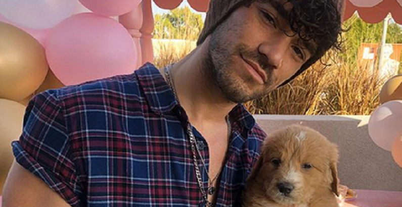 brett caprioni with puppy on instagram