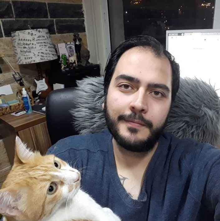 90 Day Fiance's Adam the translator poses with Pluto the cat