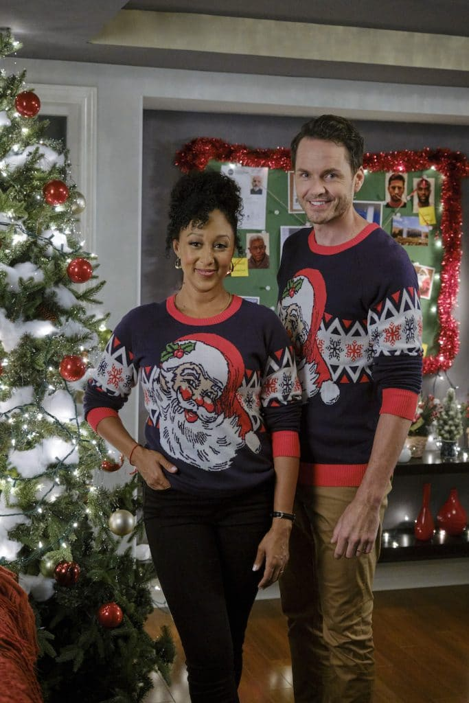 Hallmark, The Santa Stakeout-Photo: Tamera Mowry-Housley, Paul Campbell Credit: Copyright 2021 Crown Media United States LLC/Photographer: Allister Foster